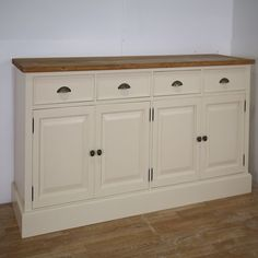 Mottisfont solid pine painted large welsh 4 drawer 4 door dresser base, Also available waxed or painted in white, cream, blue or green with choice of wooden knobs or metal handles. There is one removable shelf within the cupboard.Making this a great storage unit for any kitchen, hallway,dining room or living room