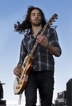 Frank Sidoris of the Cab. Now one of Slash's Conspirators! Picture him with a bass and you've got Benji Staffon from Jagged Ivory.