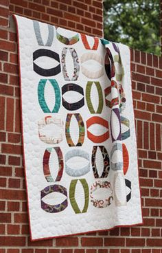The pieces of fabric in one Layer Cake™ take care of the colorful segment in all 40 blocks of this quilt by Brigitte Heitland called Oho.