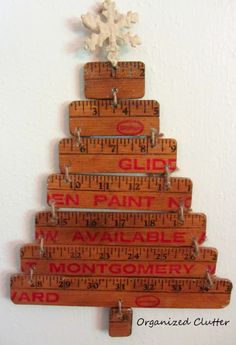 Organized Clutter: Re-Purposed Yardstick Christmas Tree. (add hooks for kids to hang ornaments?)
