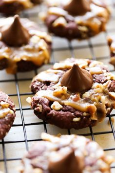 These HERSHEY'S KISSES Turtle Pudding Cookies are soft, chewy and loaded with chocolate, caramel and pecans! They are topped with a HERSHEY'S KISSES Chocolate for the perfect finishing touch!