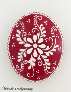 Hand painted rock with Red and White Decorative Flowers. Its a Great Gift Idea or Decorating Idea for Your Home,Office!  Its painted on a natural sea rock with acrylic paint and very small brushes.The rock is sealed with varnish for protection and signed on the back by me. Dimensions: The weight of the rock is 127 g.,height 7,2 cm and width 5,7 cm .  Your rock painting will arrive carefully packaged.  My paintings on rock are handmade individual pieces of art !  The painted stones are NOT…