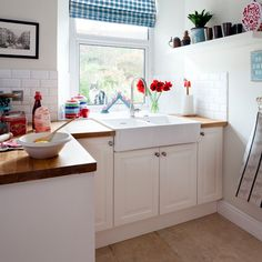 White country-style kitchen with butler sink