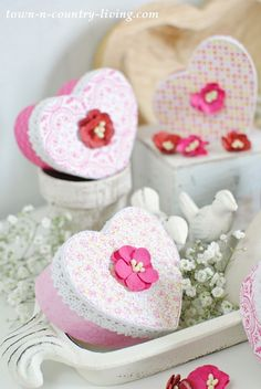 See how to make pretty Valentine Heart Boxes from plain paper mache boxes. Decorative scrapbook paper, lace, and small flowers are all you need!