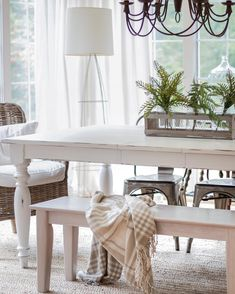 White Farmhouse Table With Wicker And Metal Chair Combination
