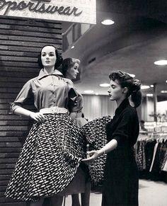 A salesgirl dressing a department store mannequin, Detroit, 1955.