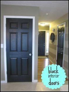 Love this look! Black painted interior doors...plus a neat hint on painting them & painting the door knobs & hinges by ina