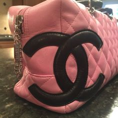 "SOLDHP 8/30Chanel Ligne Cambon Bowler Bag SOLDAuthentic Pink Chanel quilted lamb skin leather Ligne Cambon Bowler with dual black rolled handles, interlocking CC at front, back slip pocket, interior zip and wall pockets, silver tone hardware and top zip closure. Serial number 9047766. No card but have receipt of purchase from the Real Real, they sell authentic only. Shoulder strap drop 10"", height 6"", width 10"", depth 4"". Very good condition. Light wear throughout; faint discoloration…"