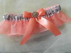 An elegant prom garter silver sequences and coral organza- This garter set is embellished with a satin bow, centered with a sparkling rhinestone .  ~~~ ~~My wedding garter are made-to-order and comfor