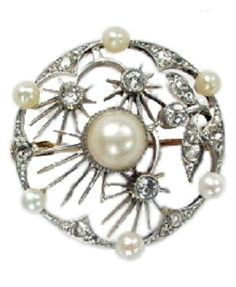 An Edwardian white gold, pearl and diamond brooch, circa 1905. Of openwork design composed of a central single pearl surrounded by a floral motif set throughout with rose-cut diamonds, set within a pearl and rose-cut diamond border. Year 1905 was also the annus mirabilis of Albert Enstein, publishing papers that lay the foundations for quantum physics, introduced the special theory of relativity, explained Brownian motion and proved the existence of atoms.