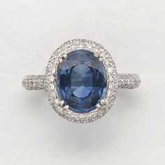 18K WHITE GOLD, SAPPHIRE AND DIAMOND RING 1 sapphire and 184 diamonds approx 4.10 & 1.30 cts,