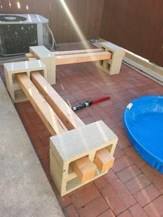 Wood and cinder block bench. Mine was a bit low, but the height was perfect for my toddler...now to get a firepit... :) all in all I'm happy with it. Fits maybe 2 adults 3-4 kids. I was trying to stretch my material. If I'm not happy later, I ll just run to home depot and buy a few more cinderblocks.