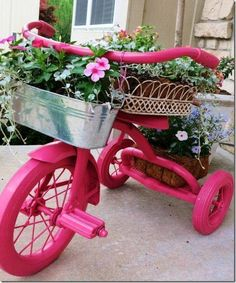 Trike gardening: Paint a garage sale find child's bike in one color and display it in the garden with flowers - by >Junky, Funky, Rusty, and Re-purposed by Sue< on FB