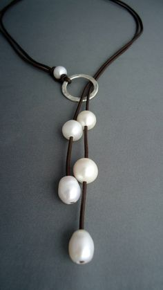 Leather and pearls Hammered sterling silver lariat, Leather Necklace,Sterling…Cord and pearls hammered sterling silver lariat. Making this! Looks like a fast, easy & beautiful necklace to make for a gift, too! Gemstones could be substituted for the pear Pearl Jewelry, Wire Jewelry, Beaded Jewelry, Jewelery, Handmade Jewelry, Handmade Rugs, Indian Jewelry, Gold Jewelry, Jewelry Necklaces