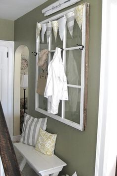 Window Coat Hanger. I have been thinking of doing this concept in my windowless powder room with no towel racks!  Need to get on it!