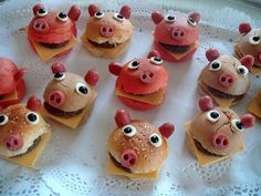 How cute!!! Sliders with piggie faces (faces are made from hot dogs, cheese and olives- how creative!)
