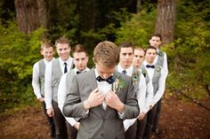 Ignore the ugly bowties and peacock feathers, I love the groom in a jacket and the grooms men in vests!