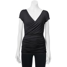 Candie's Juniors' Asymmetric Shirred Top, Size S Make your presence known in this delightful juniors' asymmetric Shirred top from Candie's . Wrap front Ruched sides Slubbed jersey construction Back Sean Drapeneck Cap Sleeves, rayon and spandex size: Small , color : black Candie's Tops Tees - Short Sleeve