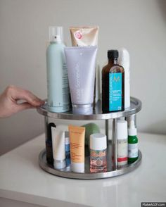 put everyday bathroom items on a spinning rack to save counter space