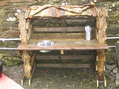 looks like some pallets. so many ideas for the hubby:) Outdoor Play Kitchen, Mud Kitchen, Daycare Spaces, Kids Playing, Recycling, Dining Table, Nursery, Pallets, Furniture