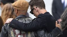 """""""Brad Pitt, Pharrell Williams, Billy Idol and numerous members of rock royalty joined mourners Friday at Soundgarden frontman Chris Cornell's Hollywood, CA memorial service. Lars Ulrich and James Hetfield of Metallica, Dave Navarro of Jane's Addiction, Chester Bennington of Linkin Park and bandmate Tom Morello, also attended. The service will be followed by a public memorial and viewing of Cornell's final resting place at 3 p.m."""""""
