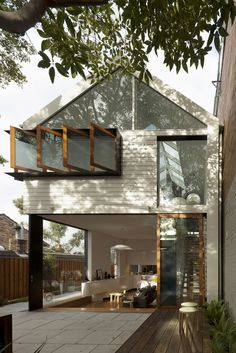 In the Sydney, Australia, neighborhood of Rozelle, architect Christopher Polly has renovated a house with green design in mind. By opening up the plan, adding floor-to-ceiling sliding glass walls to the rear of the house, deftly organizing windows, and repurposing elements of the original structure, Polly has created a structure that's attuned to its environment
