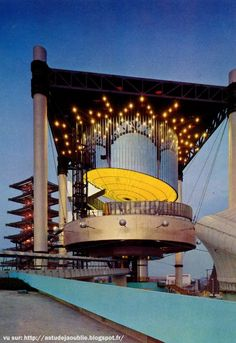 "Electrium Pavilion - Architectes: Junzo Sakakura et Yutaka Murata   Theme: ""Man and Energy"", The ""Electrium"" pavilion to be built jointly by the nine major electric power companies of Japan will look like alamp at night."
