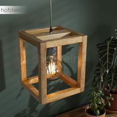 The ceiling Light Hooper 1 pendant has a rectangular open frame, which can be adjusted in height to your preference. The lamp is made of light mango wood. Luminaire Original, Retro Table Lamps, Industrial Ceiling Lights, Wood Lights, Retro Lampe, Bois Diy, Wood Pendant Light, Wooden Lamp, Swag Light