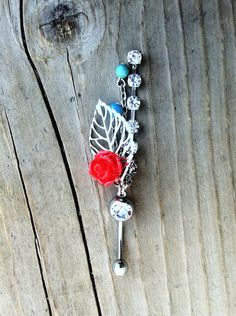 Turquoise and Red Rose Leaf Belly Button Ring. $14.50, via Etsy.