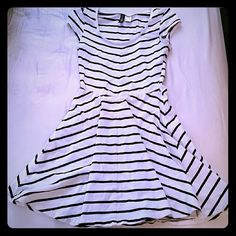 H&M Striped Skater Dress Black and white striped mini dress, stretchy material, size 4. Features a scoop neck and little cap sleeves! Looks great alone or with leggings and a cardigan, jeans, boots and a leather jacket. Divided Dresses Mini