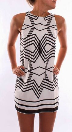 white mini dress with black motifs