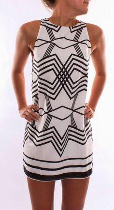 white mini dress with black motifs