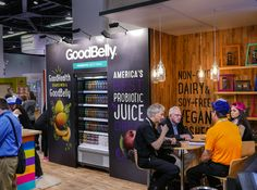 We created this vibrant and energetic trade show booth design for Good Belly in order to showcase their fruity flavor options