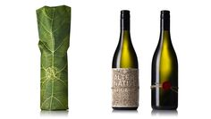 """Organic packaging to launch an organic wine. #SustainablePackaging """"Every endeavour was made to ensure the packaging was as organic and environmentally friendly as possible: balsa wood with its laser etched detailing, the string and wax seal used to affix the label, the outer paper wrap stock and even the inks used to print the image."""""""