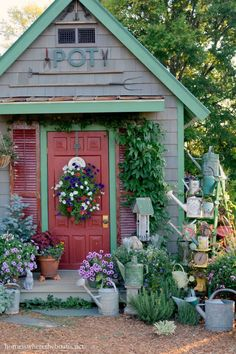 Potting Shed and Watering Cans sprinkled on a ladder! | homeiswheretheboatis.net #pottingshed #garden