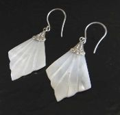 These white mother of pearl shell and sterling silver earrings are a pretty textured diamond shape.
