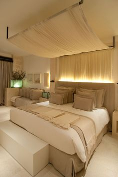 Life is but a dream in this neutrally decorated bedroom-- gorgeous!