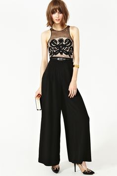 Totally chic black wide-leg jumpsuit featuring a mesh top with embroidered baroque detailing.Racerback with hook/eye and zip closures. Partial nude lining. Looks perfect with cat-eye liner and luciteheels!