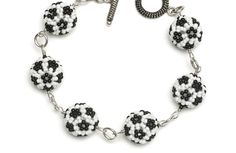 Soccer, Anyone? ___ Beaded Bead Set = Earrings and Bracelet ___ By Aurelio Castaño ___ DL pattern here - http://bnb.jewelrymakingmagazines.com/-/media/Files/PDF/Subscriber%20projects/2011/BNB-ONS0111.pdf