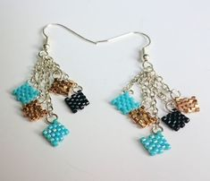 I made these adorable Confetti Earrings! Created using Delica beads in Aqua Blue, Black and Gold, these silver dangle earrings are sure to impress! Jewelry DIY, jewelry ideas, etsy jewelry, jewelry making
