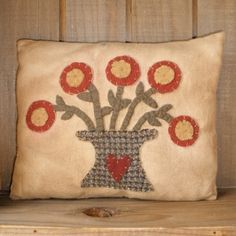 Hey, I found this really awesome Etsy listing at https://www.etsy.com/listing/70514729/primitive-pot-of-flowers-appliqued