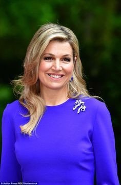 The blue gems in Queen Maxima's drop earrings and bracelet perfectly matched her dress...