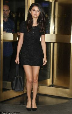 f034aac16 Beautiful in black  Selena Gomez showed off her enviable figure in a  textured
