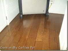 brown paper bag floor looks like wood floor -- do this in a bathroom?  Cool!