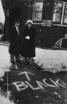 """(via Twitter) """" Chicago, 1957: a couple who moved into an all-white neighborhood looking at graffiti in front of their home.  """""""