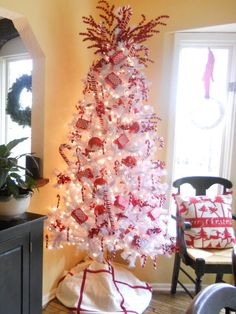 Candy canes are a staple holiday treat. HGTV fan mazuy chose a white tree to create a strong background for the candy-cane ornaments. The red berry tree topper enhances the bold red ornaments.