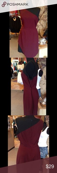 Burgundy/Black Dress This is a great career dress. Sleeveless, back zipper closure, front asymmetric black panel. 64% Polyester, 29% Viscose, 2% Spandex. Worn 2 times. Like new condition. (This closet does not trade or use PayPal ) New York & Company Dresses Midi