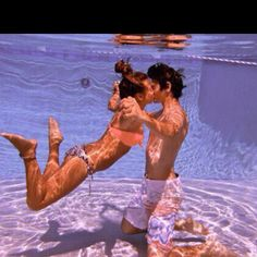 Nina Dobrev and Ian Somerhalder share a tender kiss underwater!