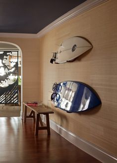 Surfboards on the wall.  Grasscloth wall covering.  House Tour: Ocean House
