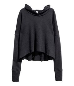 Black. Short sweatshirt with heavily distressed details and raw edges. Jersey-lined hood, dropped shoulders, and long sleeves with wide cuffs.